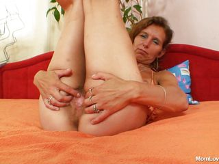 mature bitch masturbating with a marital-device in the bedroom