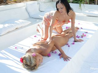 blonde playgirl receiving a massage from her lesbian friend
