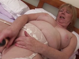 golden-haired aged satisfying her with her favorite sex toy