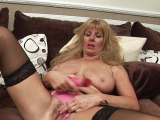 nasty blonde lady playing with a dildo