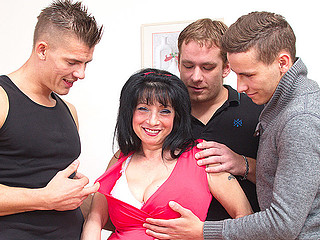 Dark haired angel is getting her mouth filled with both fat dicks