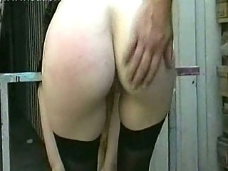 Milf slave with big bumpers receives undressed and spanked on her cookie