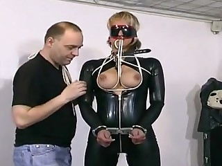 Dirty slave nymph has her boobs tied up