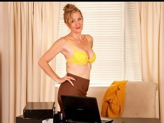 Impressive business woman takes a break to masturbate