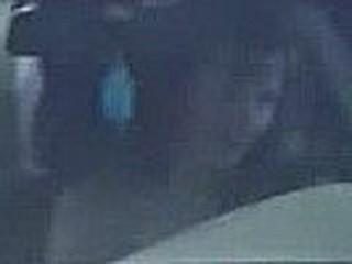 Stripped woman driving a car