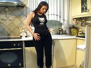 Busty chick with leather boots masturbates in the kitchen