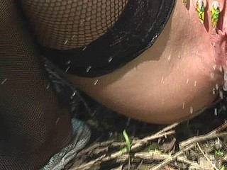Gal in stockings piddles outdoor