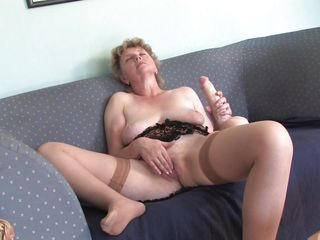 lascivious grandma masturbating with a large sex tool