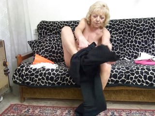 blonde granny masturbates on the sofa