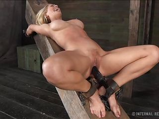 golden-haired hotty betwixt pleasure and pain