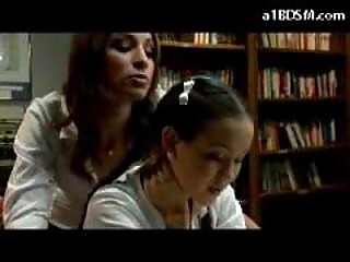 Schoolgirl In Skirt Getting Spanked By Other Beauty In The Library