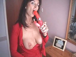 British MILF bonks herself with a couple of high heeled shoe