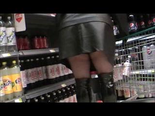 Black tights pvc mini skirt and black shiny boot