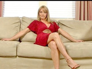 Sandy golden-haired haired cougar masturbates with a lengthy vibrator