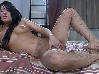 April B massaging her nylon feet