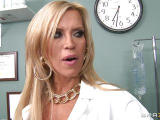 blonde aged doctor gives a titjob