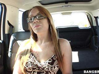 blond giving oral stimulation on back seat