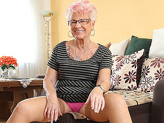 Look at this mature whore in pink underware looking seductive
