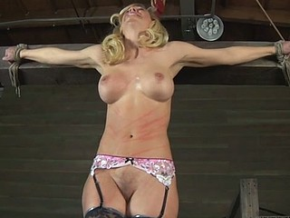 Fastened up beauty gets tongue and facial torment