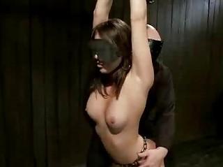 Shackled playgirl manhandled and fingered