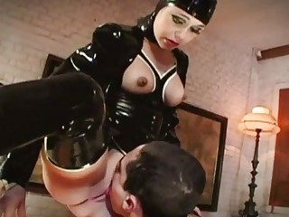 Latex wearing whore copulates hardcore cock