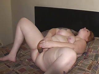 Redhead BBW masturbating on hotel daybed