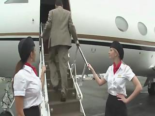 Pretty stewardess is fucking with two businessmen on the board of a plane