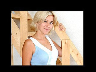 Large titted blond posing nicely in the stairs