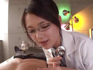 spectacled asian chick gives handjob to her patient