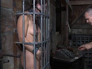 Brunette thrall gagged in cage