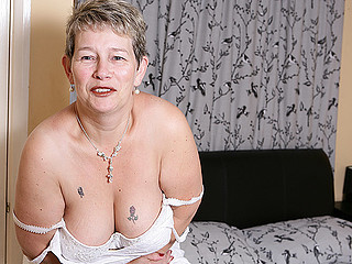 Mature horny lady is playing with her fur pie truly filthy