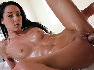 Strong hands of man are easily sliding on the oily body forms of whore