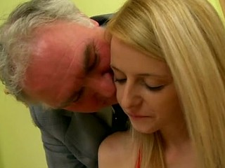 Mature old man is fingering the small vagina hole of blonde babe