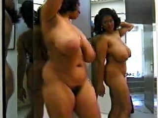 Black woman with astonishing body dancing in mirror