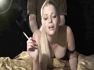 Cute blonde smoking during sex.