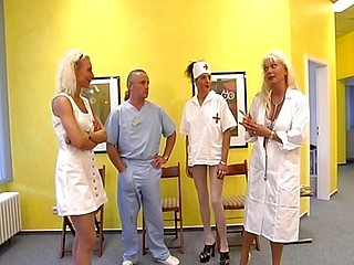 Hot blond nurse gets it on with an old dirty doctor on the floor