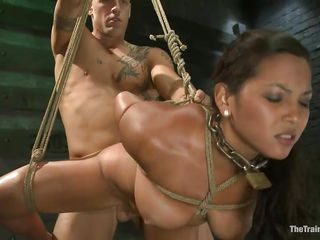 adriana is fastened and fucked by a bald muscled man