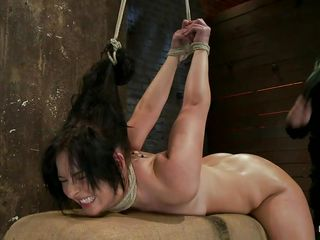 brunette fastened and drilled in the pussy and mouth
