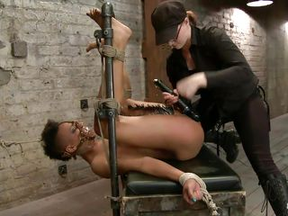 dark sex toy on a tied dark doxy