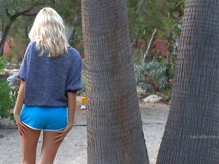 blonde skinny beauty with blue short panties relaxes
