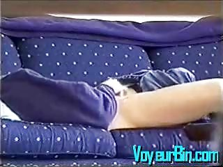 Blonde caught masturbating on a daybed on hidden cam