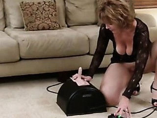 Gorgeous cougar thoroughly enjoys her 1st sybian ride